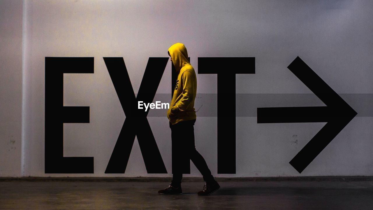 Man Walking By Exit Text
