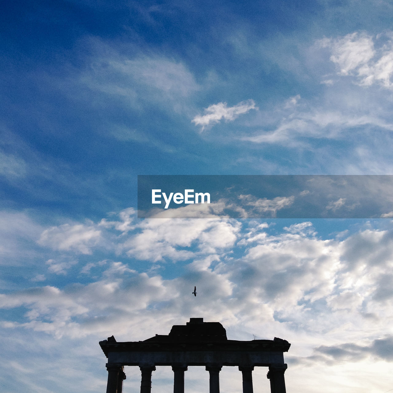 Low Angle View Of Historic Columns Against Cloudy Sky At Forum Romano