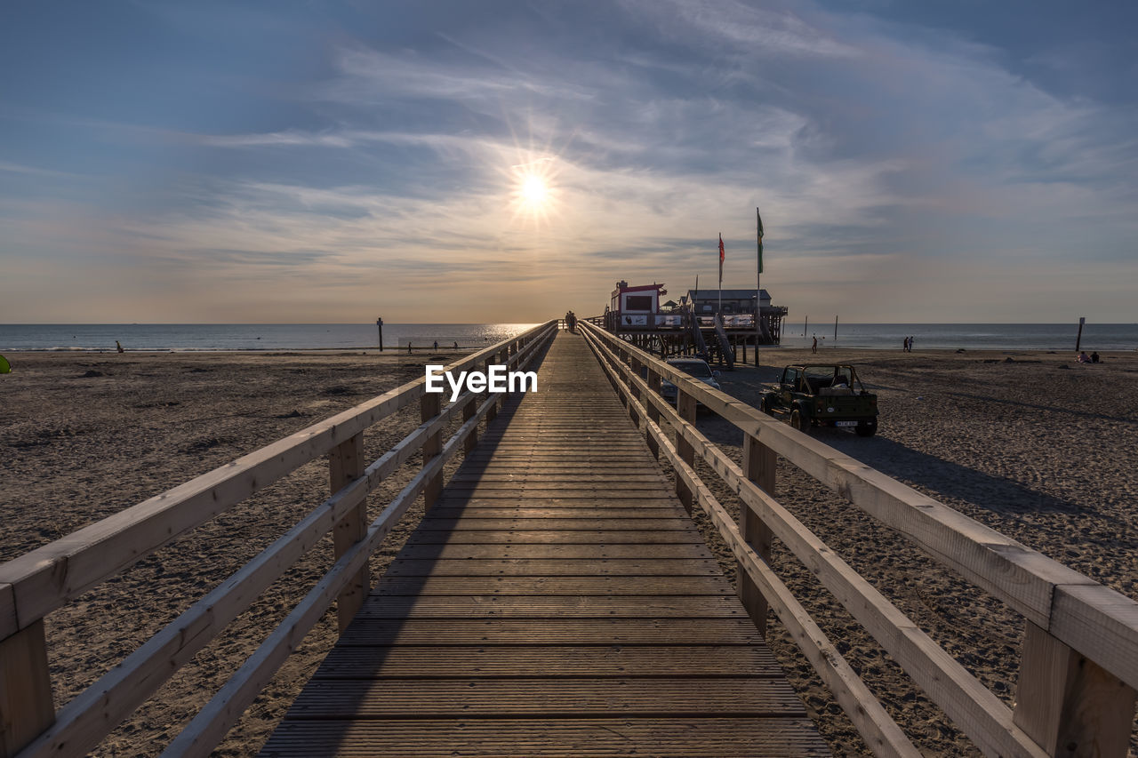 sky, direction, the way forward, cloud - sky, nature, transportation, railroad track, sunset, sea, track, rail transportation, horizon, diminishing perspective, water, railing, no people, horizon over water, vanishing point, scenics - nature, beauty in nature, outdoors
