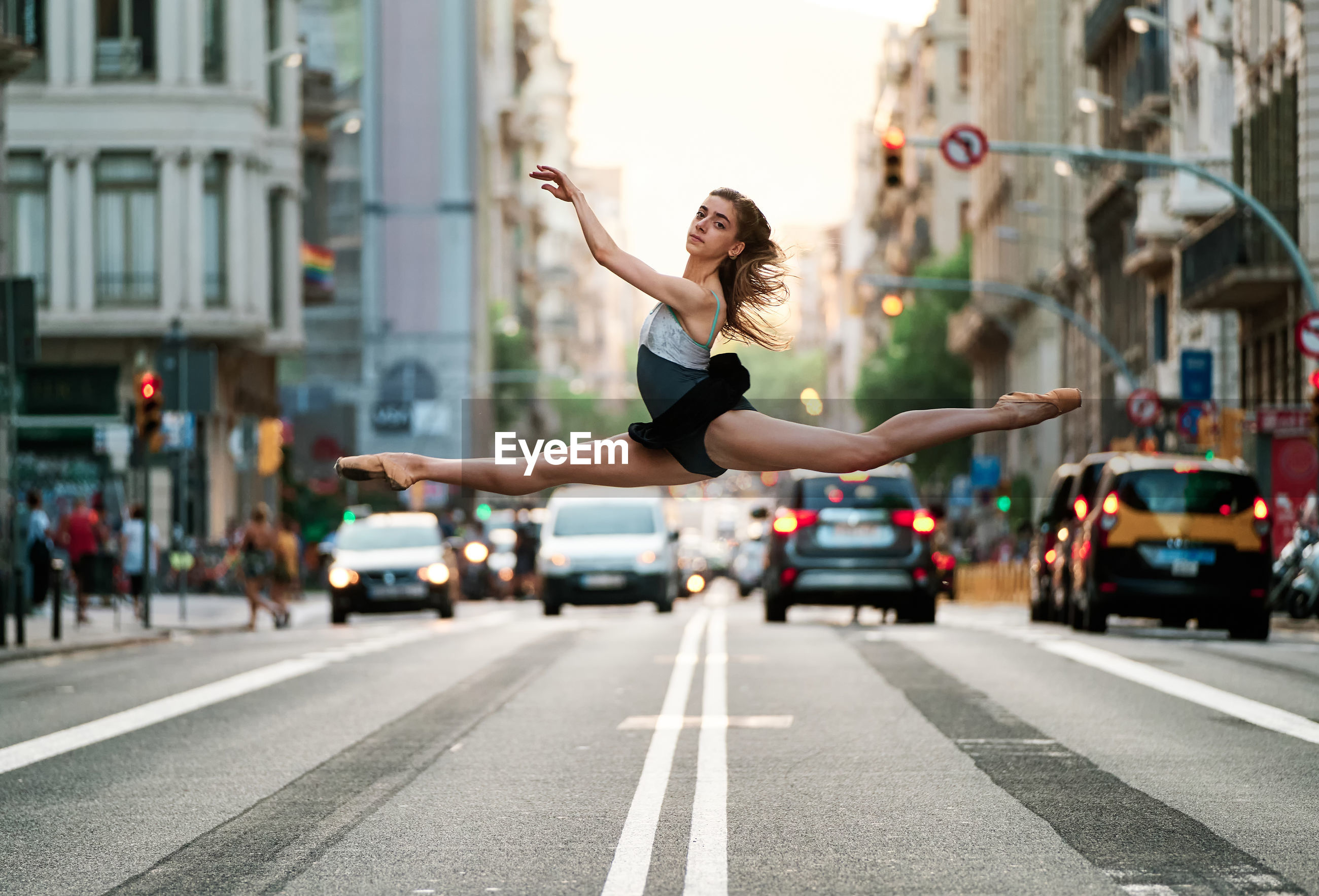 WOMAN JUMPING ON STREET