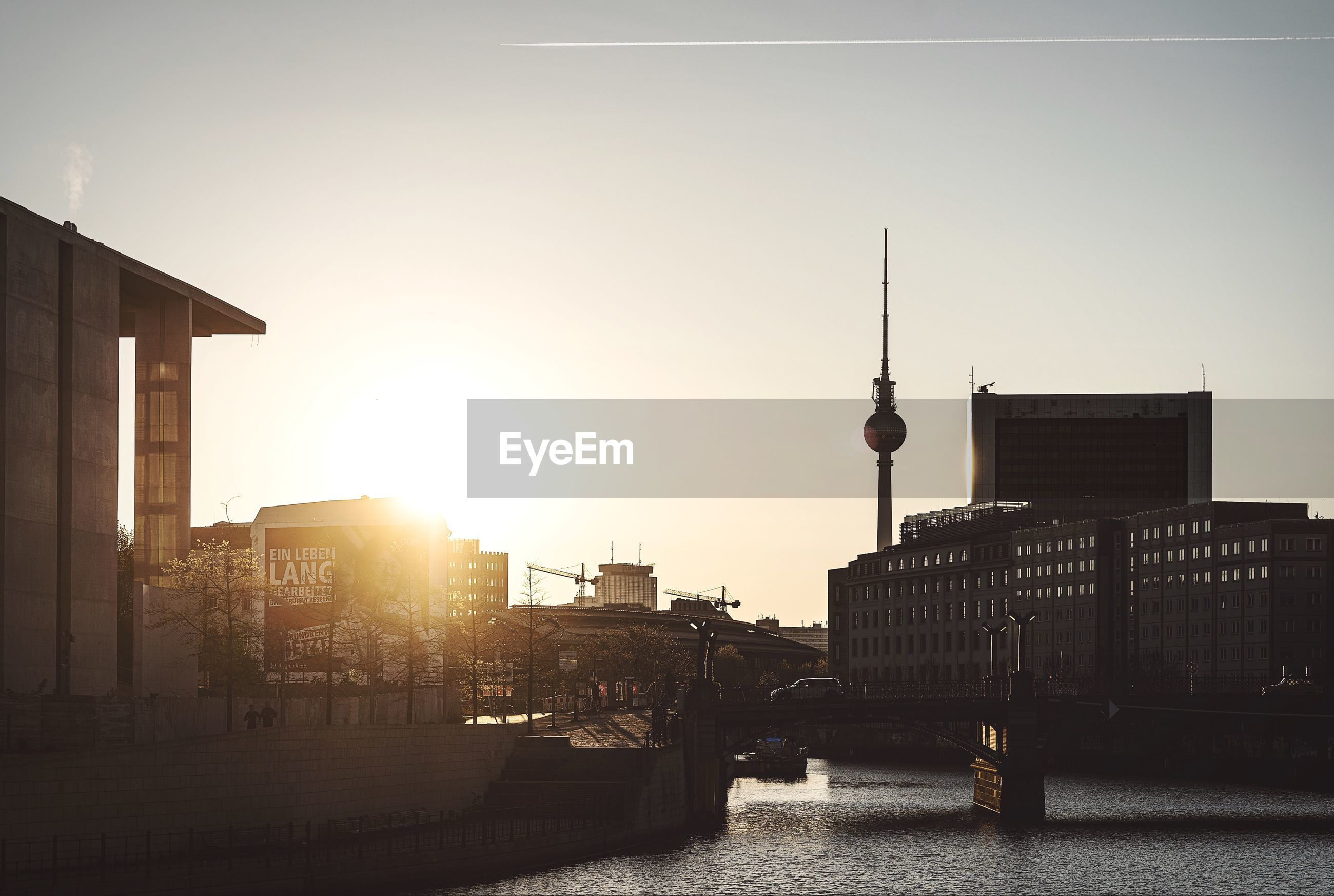 Buildings in berlin city against sky during sunset