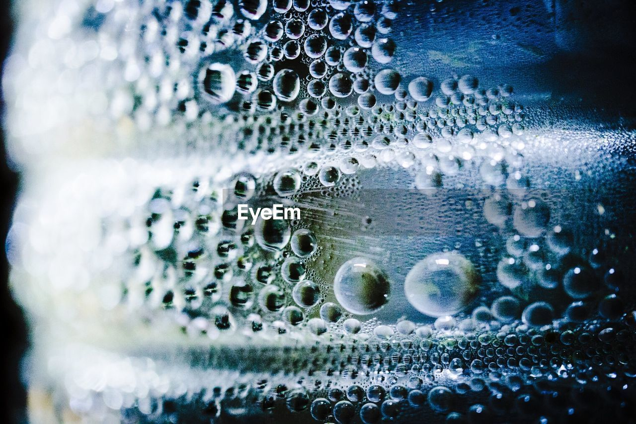 Close-Up Of Bubbles In Water Bottle