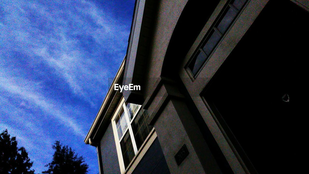 low angle view, architecture, built structure, building exterior, sky, no people, day, window, outdoors