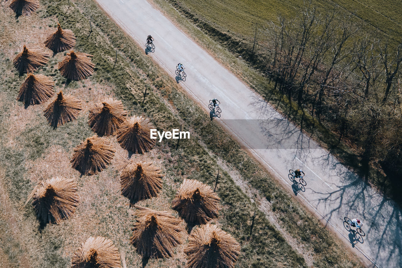 High angle view of bikers on road amidst field