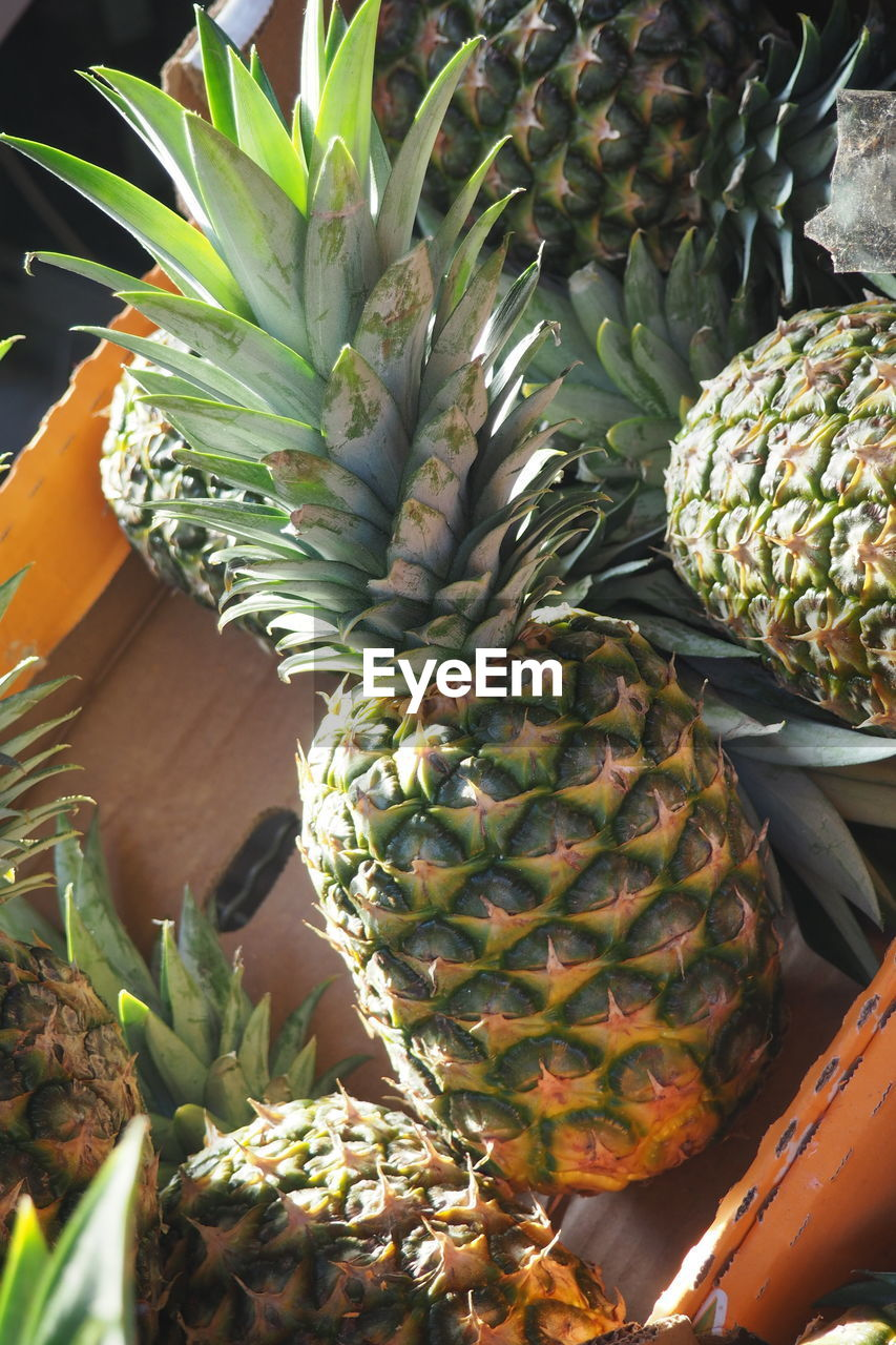 High Angle View Of Pineapples For Sale At Market Stall