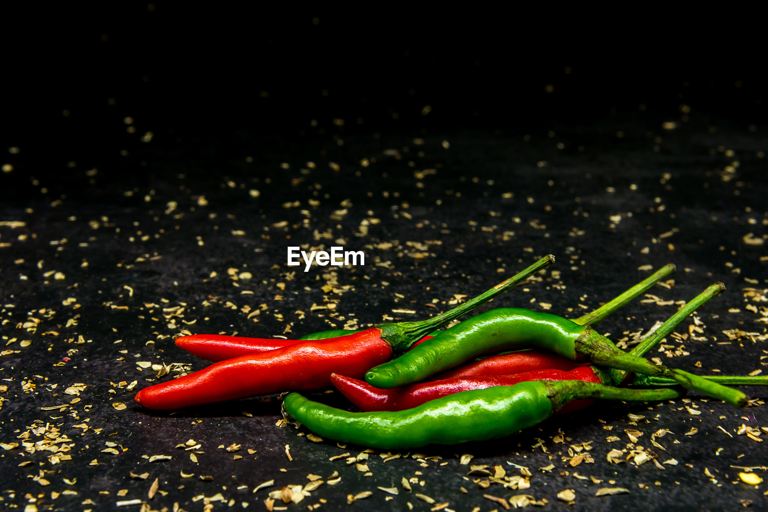 Close-up of chili peppers on black background