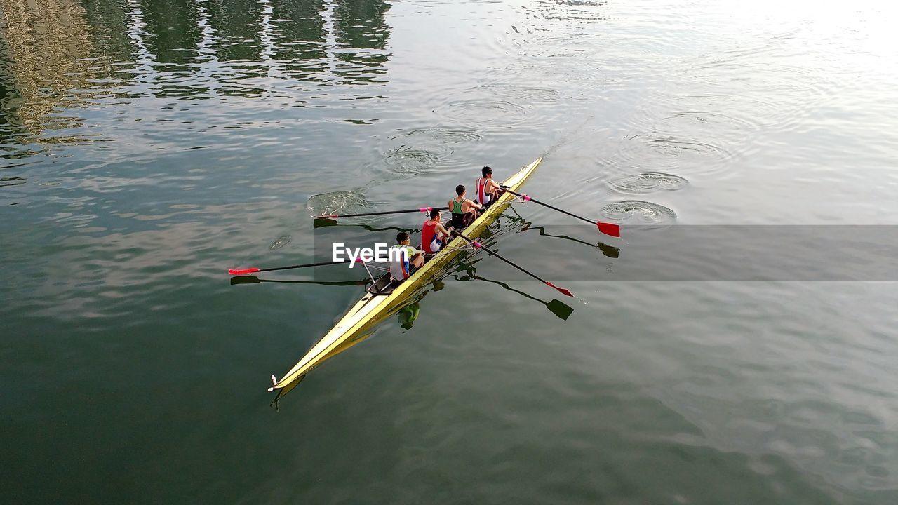 High angle view of men kayaking on river