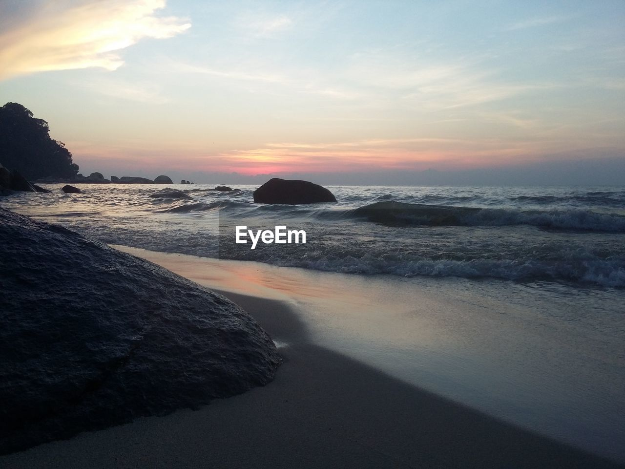 sea, sunset, nature, scenics, beauty in nature, water, tranquil scene, tranquility, beach, sky, rock - object, outdoors, no people, horizon over water, sand, wave, day