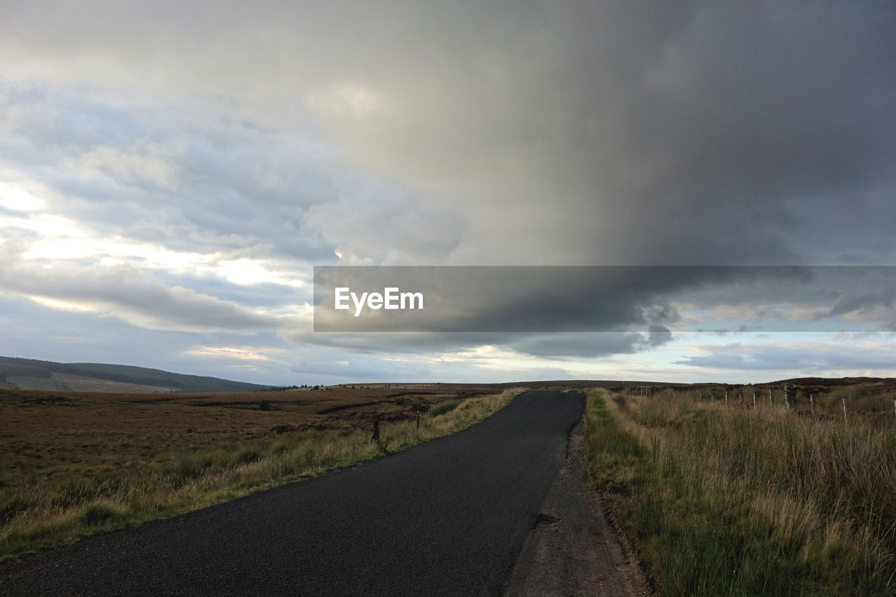 road, cloud - sky, sky, landscape, direction, environment, the way forward, transportation, tranquility, tranquil scene, land, grass, non-urban scene, field, beauty in nature, nature, no people, scenics - nature, horizon over land, diminishing perspective, outdoors, long