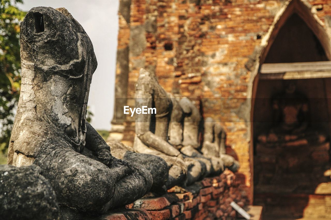 art and craft, architecture, sculpture, human representation, representation, built structure, old, the past, history, craft, creativity, day, statue, focus on foreground, religion, building, place of worship, belief, close-up, no people, stone material, outdoors, ancient civilization, deterioration