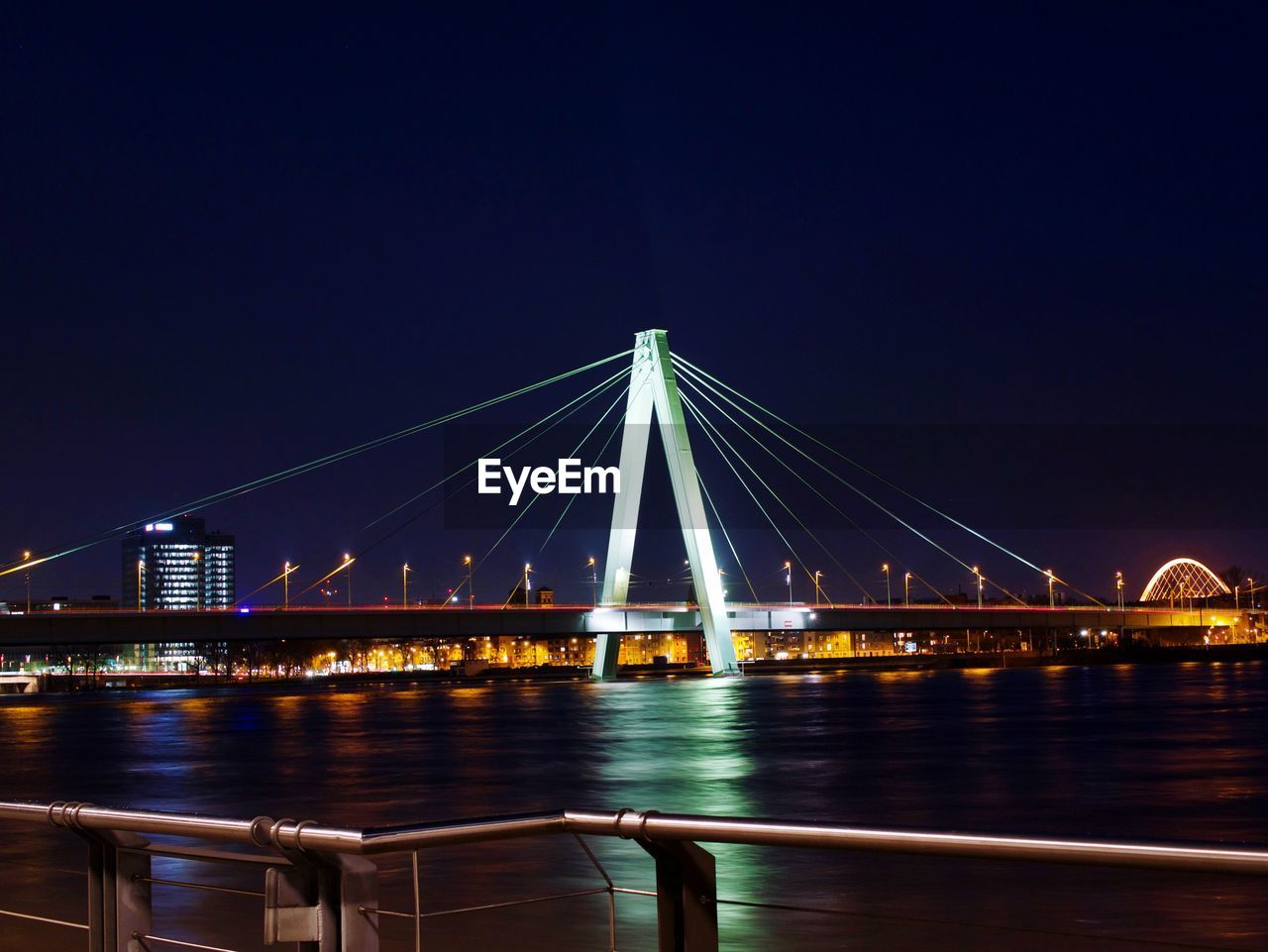 Illuminated Bridge Over River Against Clear Sky At Night