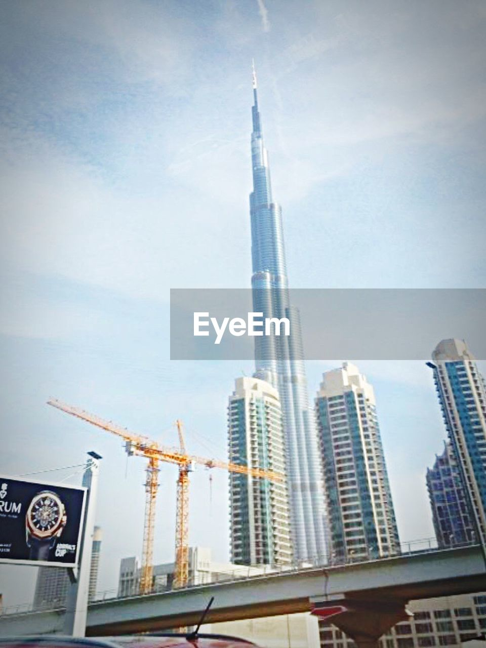 architecture, built structure, skyscraper, building exterior, city, low angle view, day, communication, outdoors, no people, modern, sky, tall, cityscape