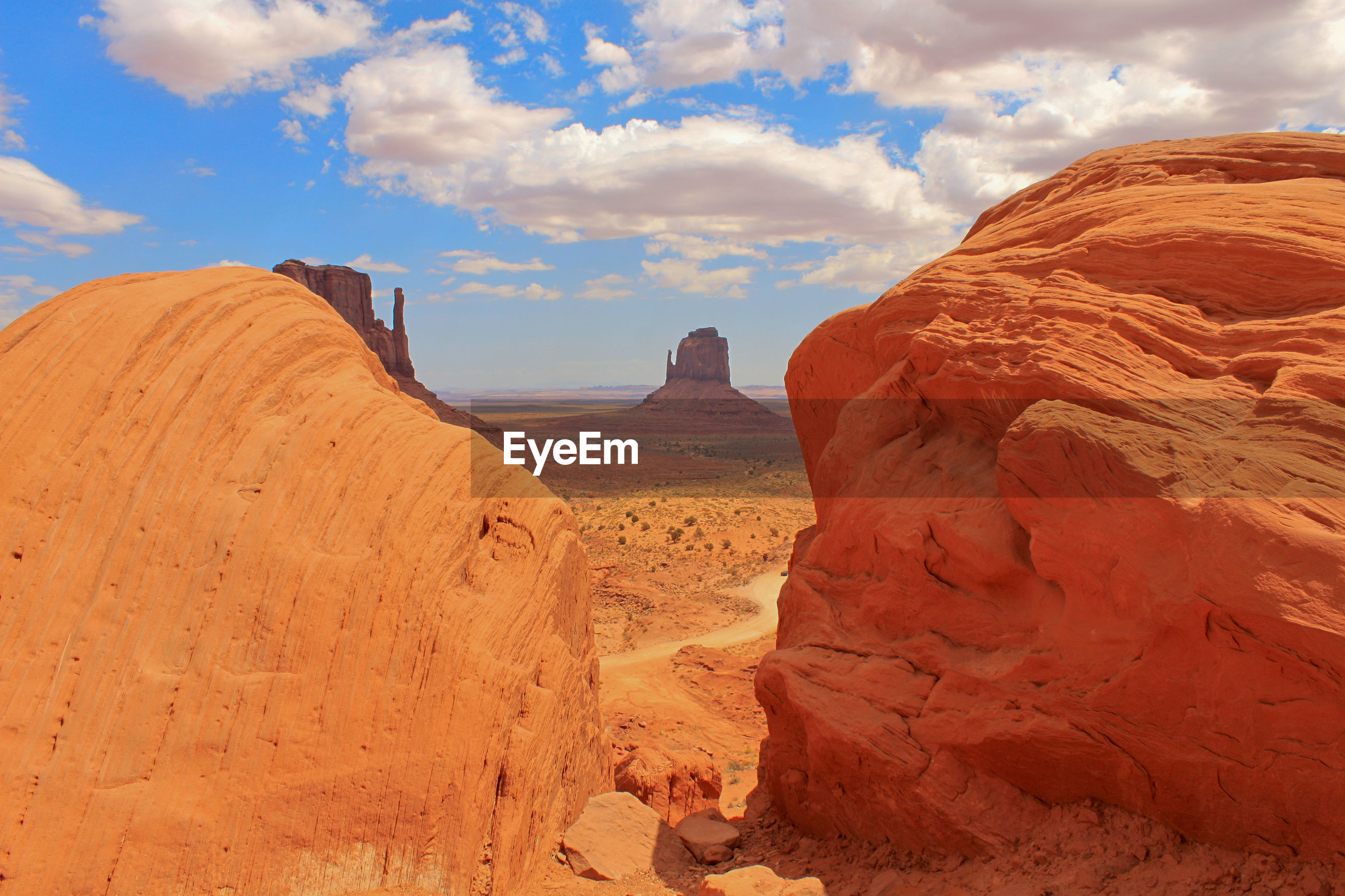 Scenic view of rock formations at monument valley against sky
