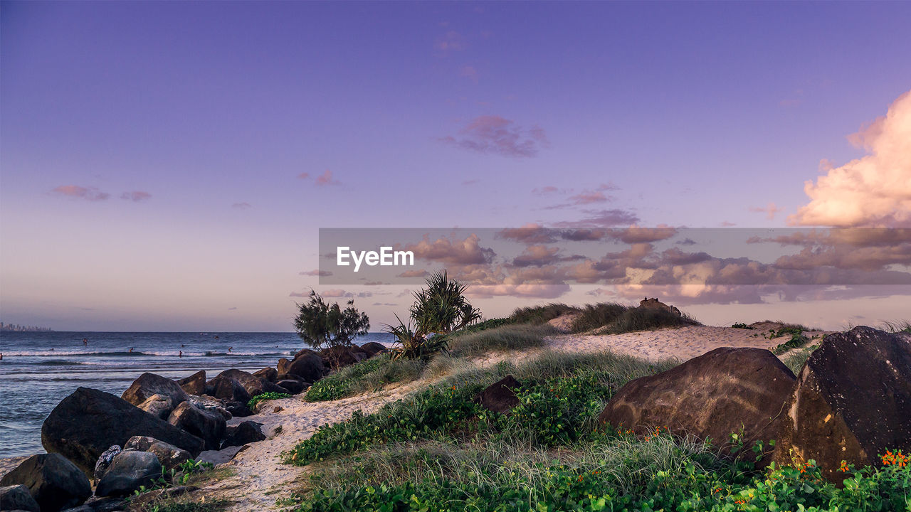 Scenic View Of Seashore Against Sky During Sunset