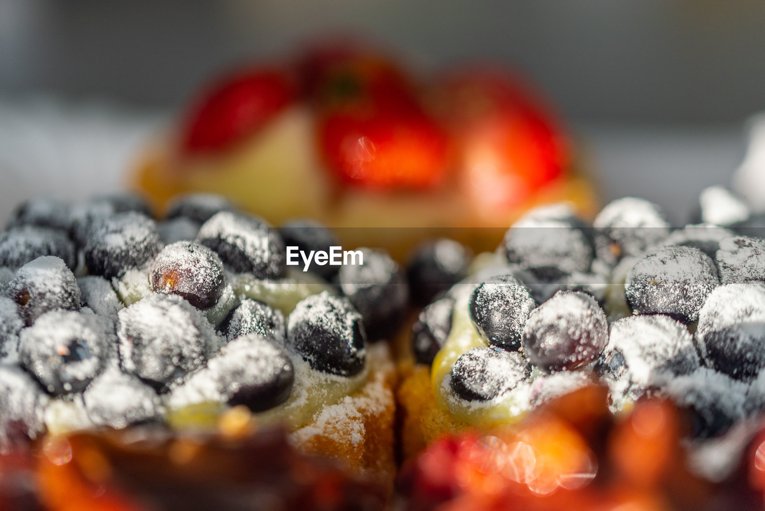CLOSE-UP OF BERRIES ON CAKE