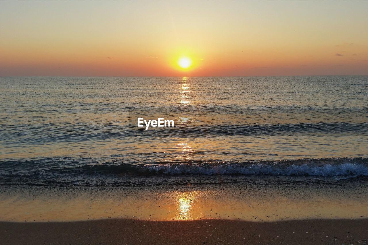 sunset, sky, water, sea, scenics - nature, beauty in nature, orange color, horizon over water, sun, tranquility, idyllic, beach, tranquil scene, horizon, reflection, land, wave, nature, sunlight, no people, romantic sky