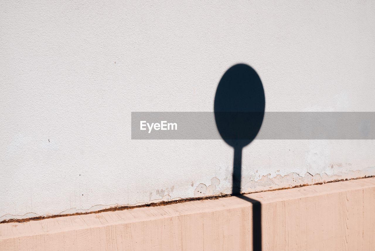 Shadow of sign board on wall