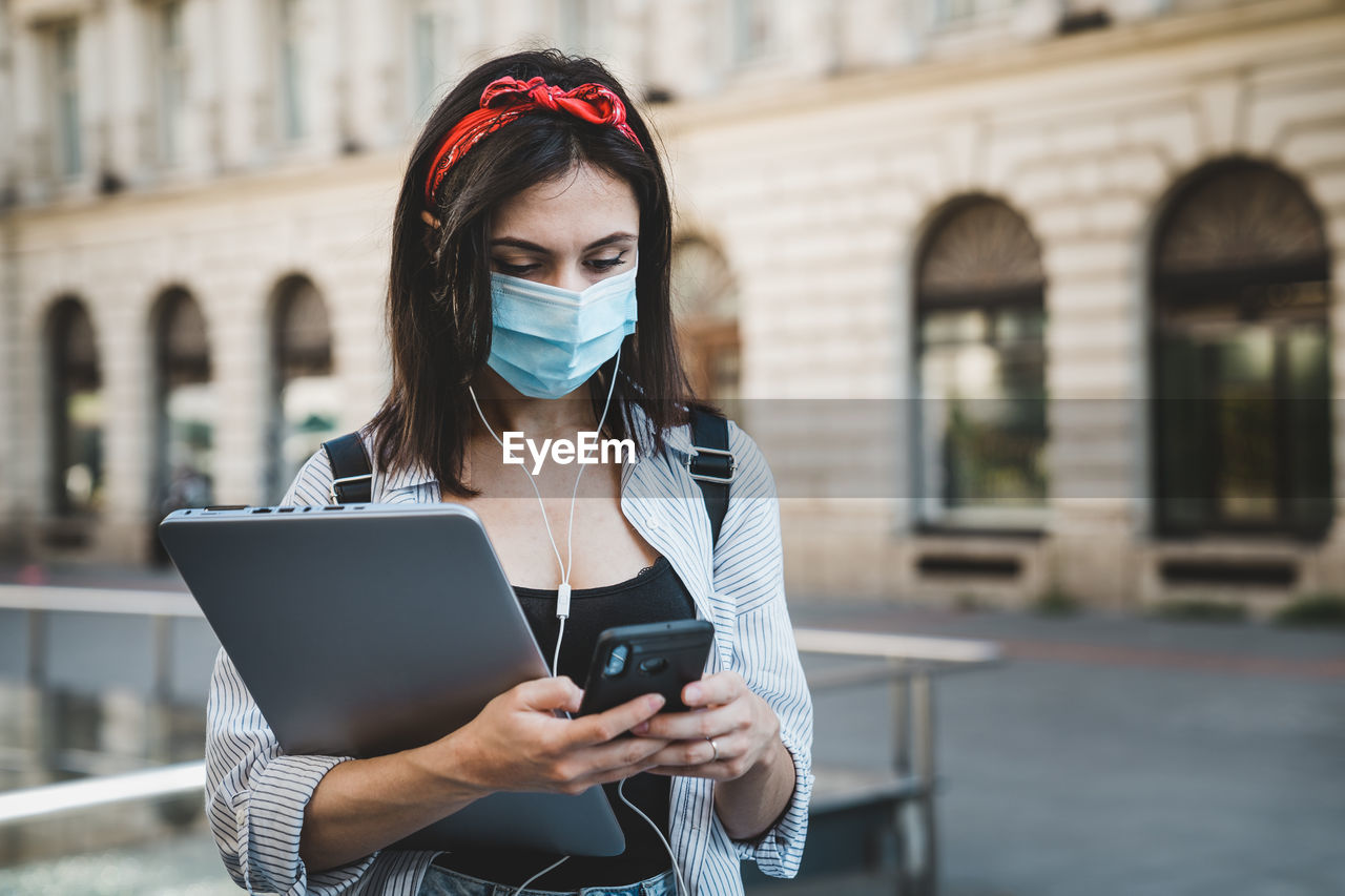Woman using mobile phone outdoors