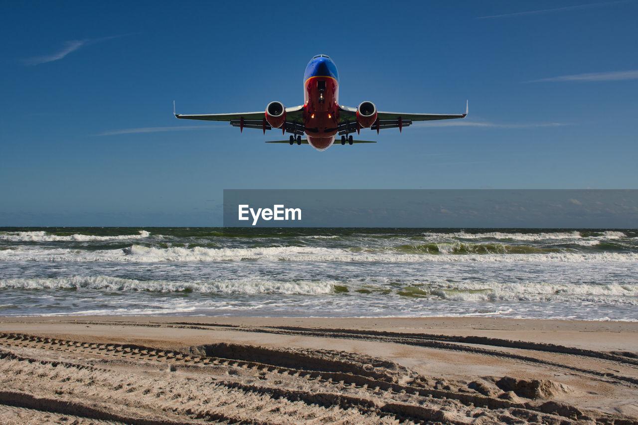 Plane over sawgrass beach florida usa