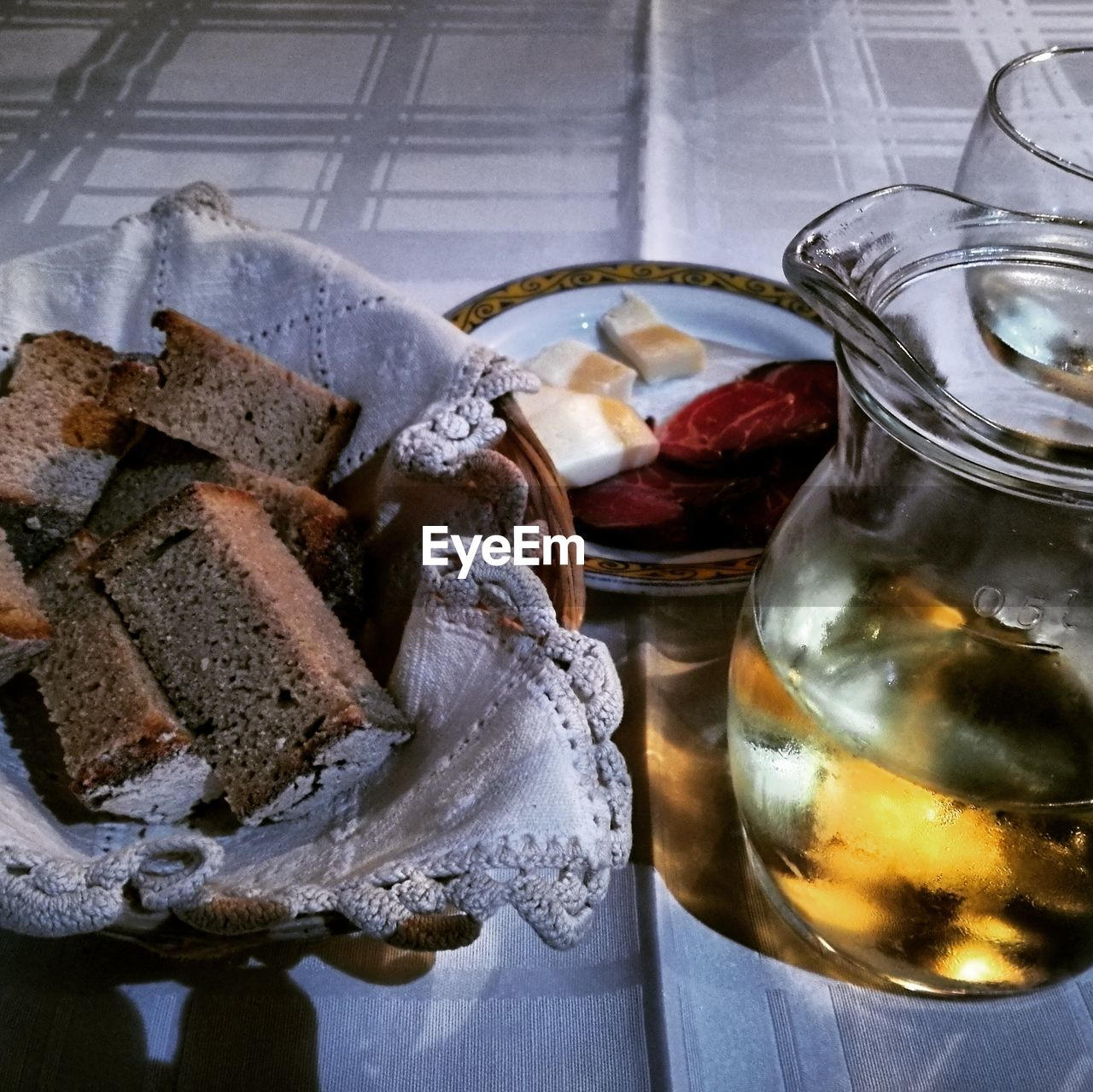 food and drink, food, freshness, still life, table, close-up, indoors, ready-to-eat, no people, wellbeing, healthy eating, serving size, refreshment, drink, high angle view, glass - material, glass, bread, household equipment, eating utensil, temptation
