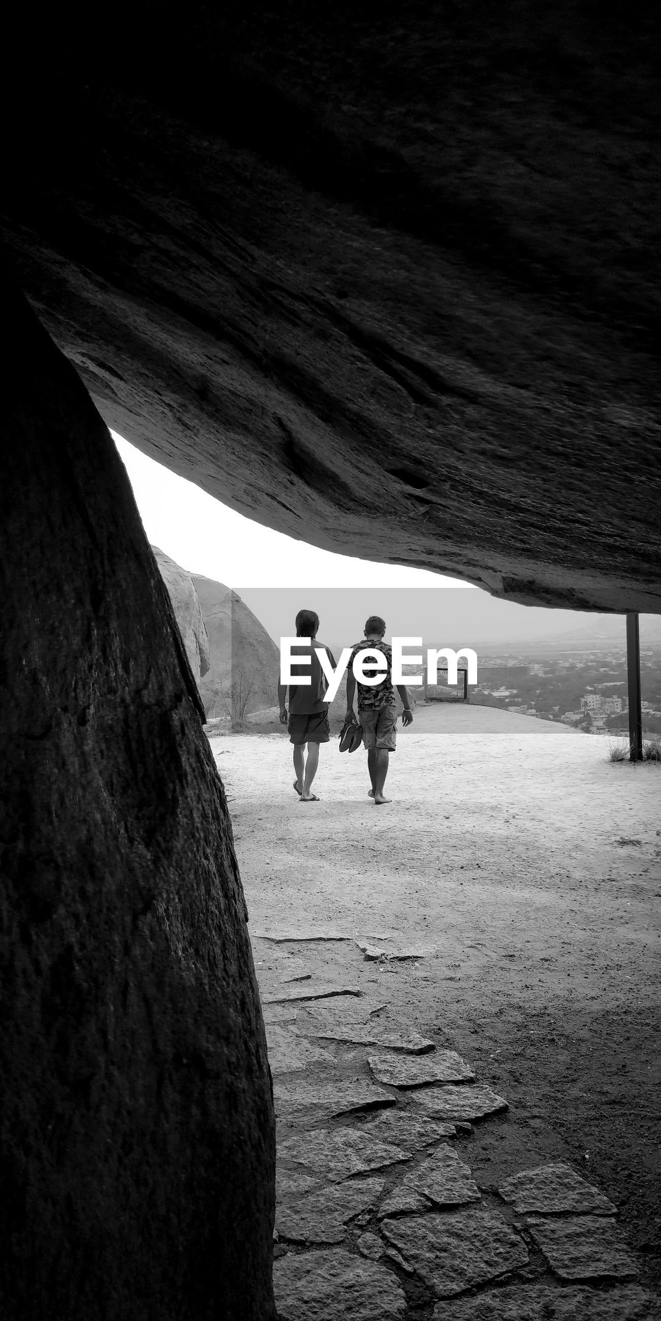 People seen through rocks