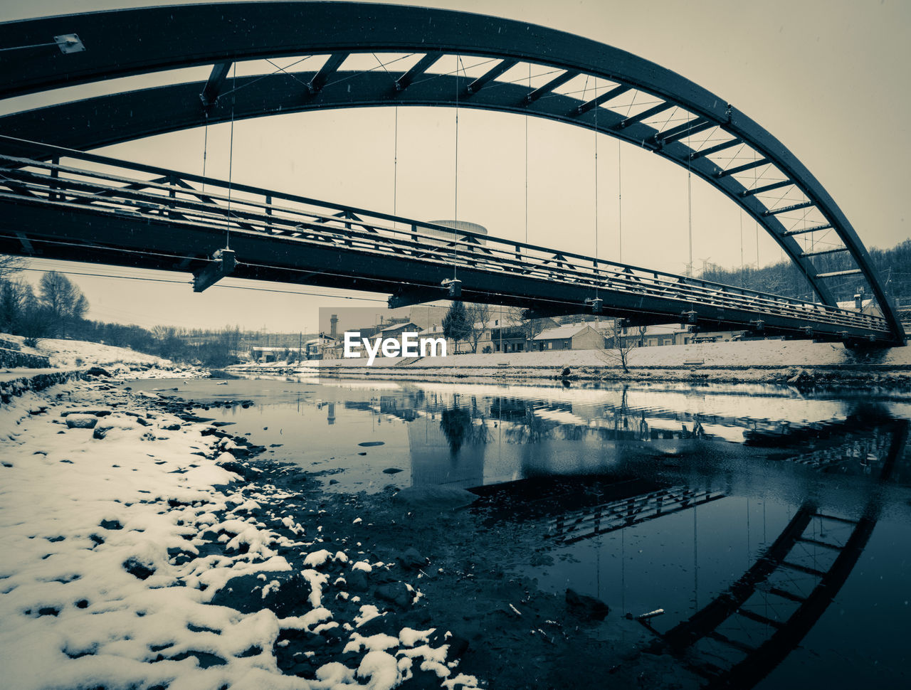 REFLECTION OF BRIDGE AGAINST SKY