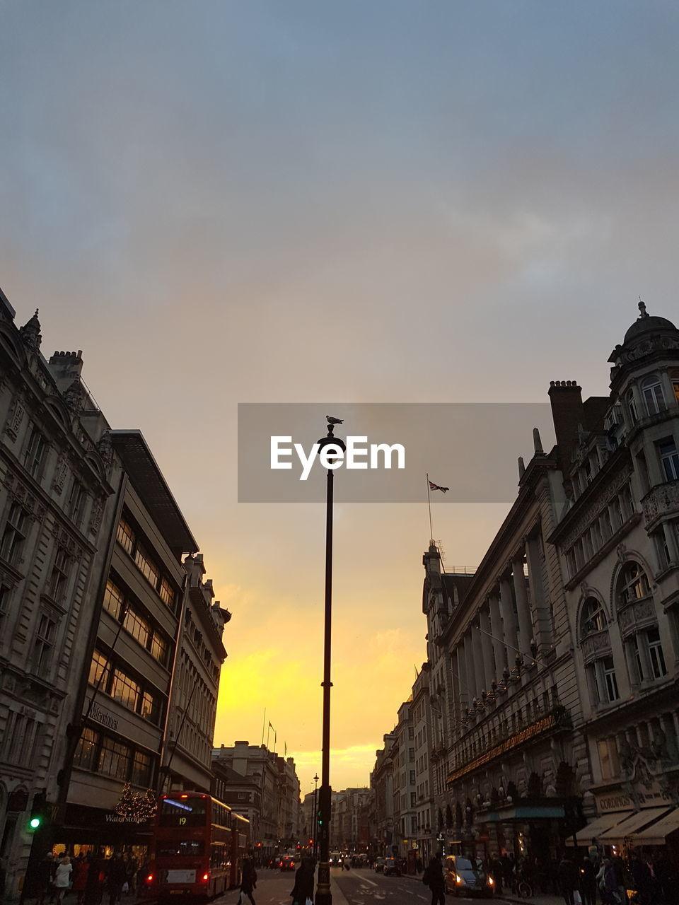 architecture, sunset, built structure, building exterior, sky, city, history, travel destinations, street light, outdoors, cloud - sky, statue, no people
