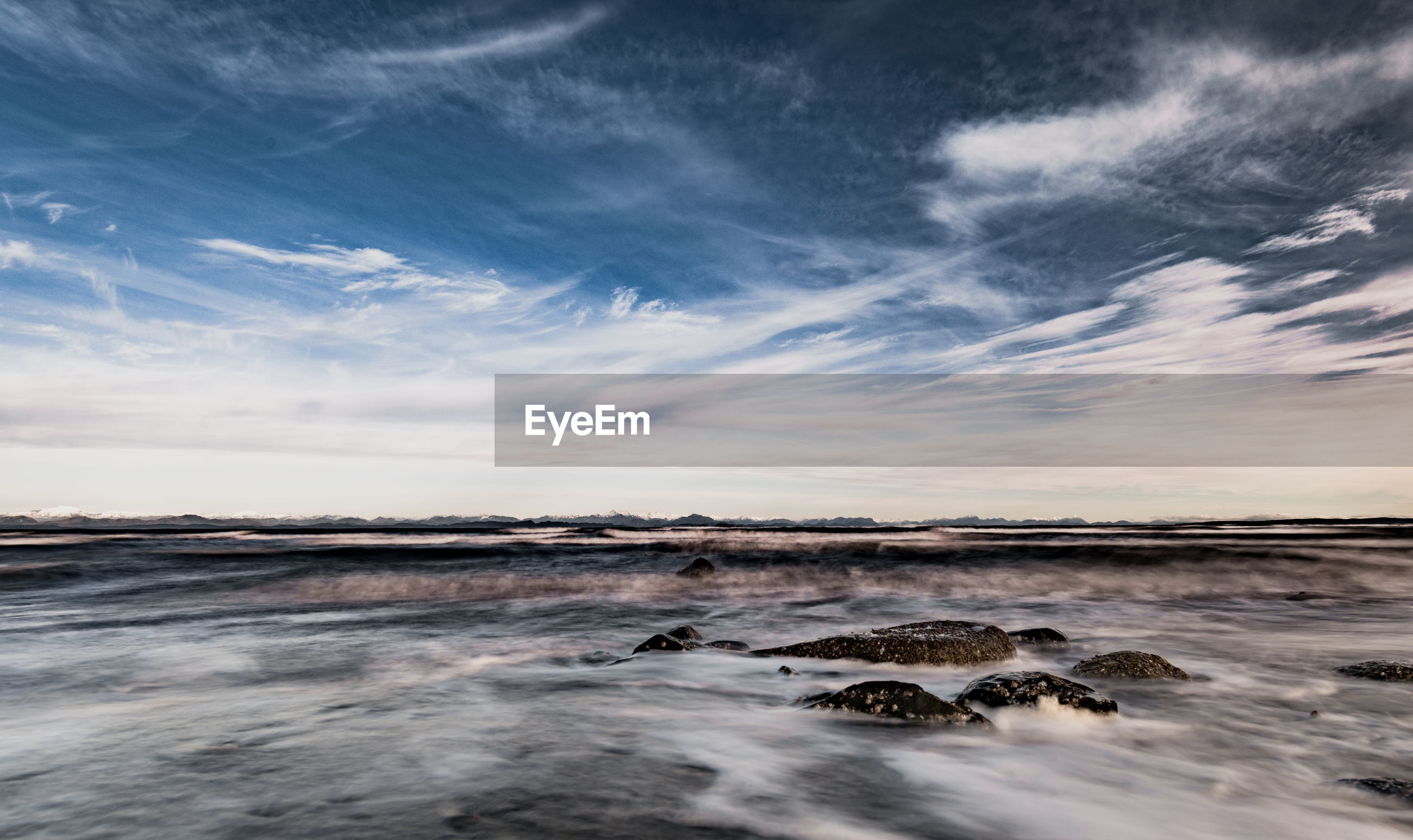 SCENIC VIEW OF ROCKS ON SEA AGAINST SKY