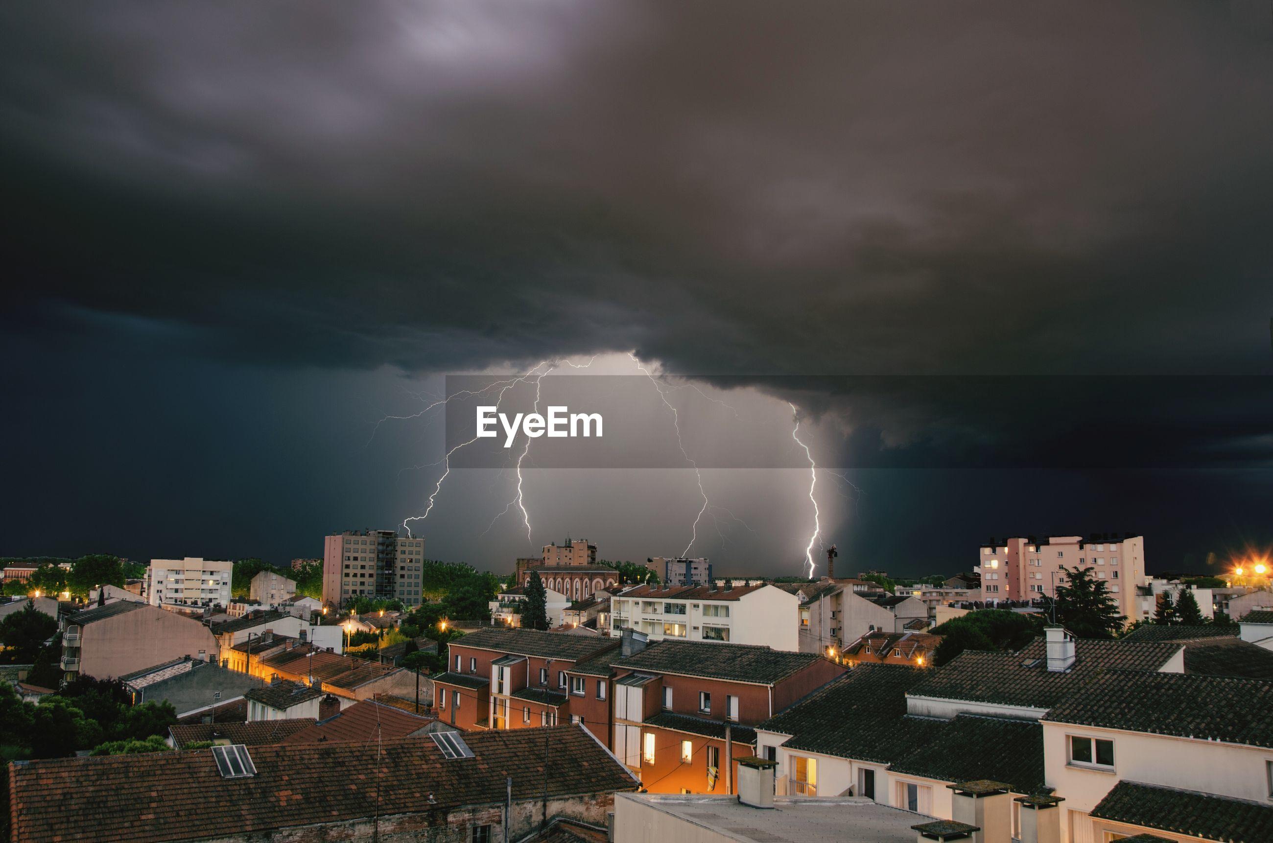 Lightning strike above built structures