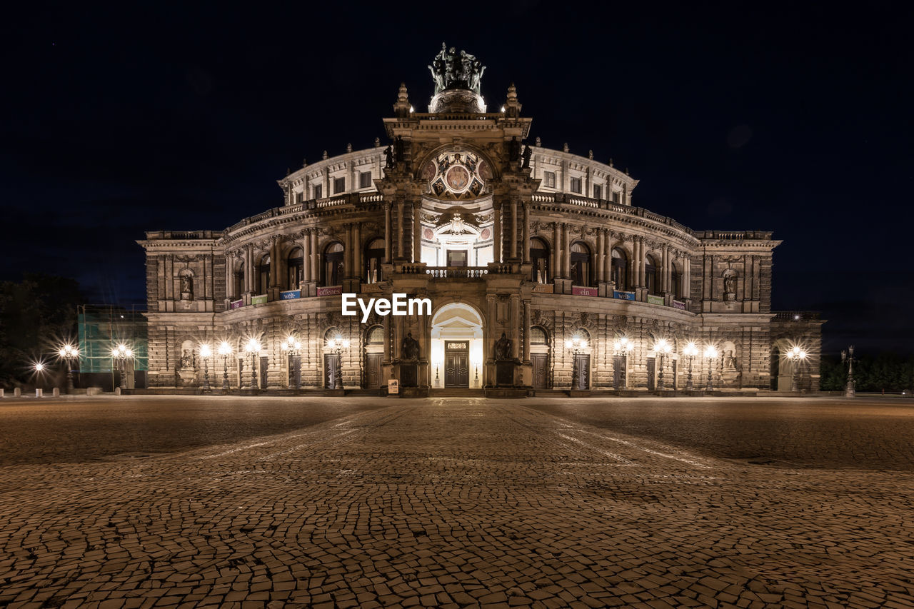 night, illuminated, architecture, building exterior, built structure, city, travel destinations, the past, history, sky, facade, arts culture and entertainment, tourism, street, cobblestone, no people, art and craft, nature, street light, neo-classical, ornate