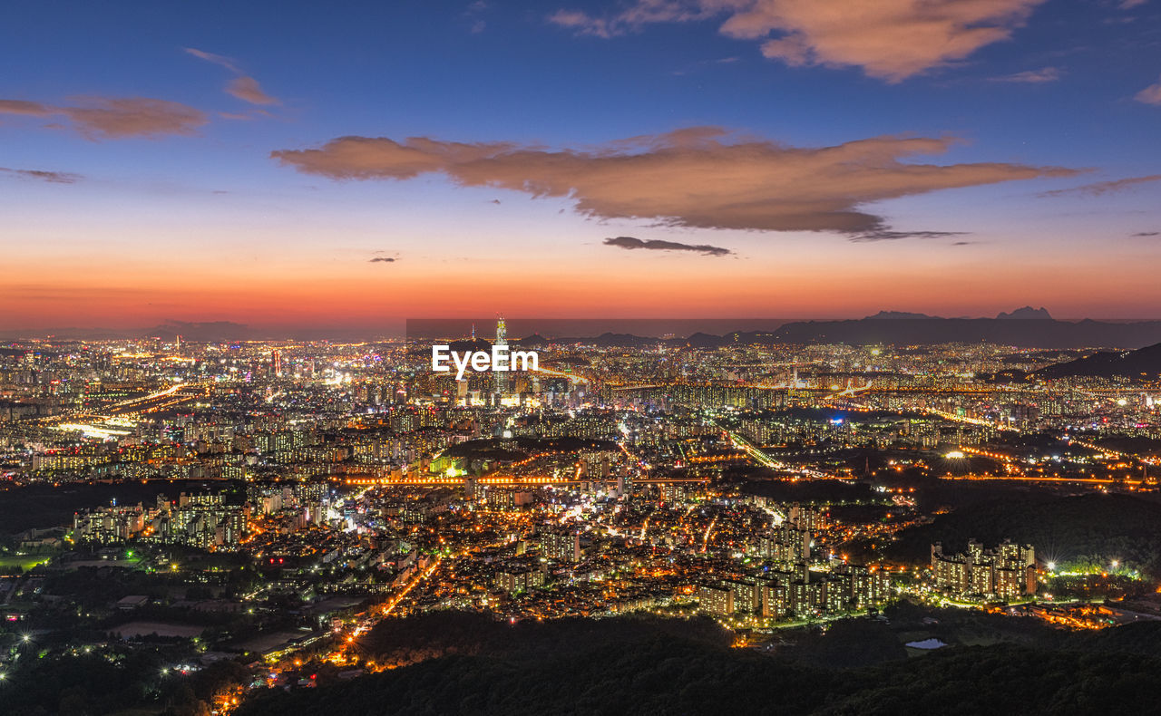 Aerial View Of Illuminated City At Sunset