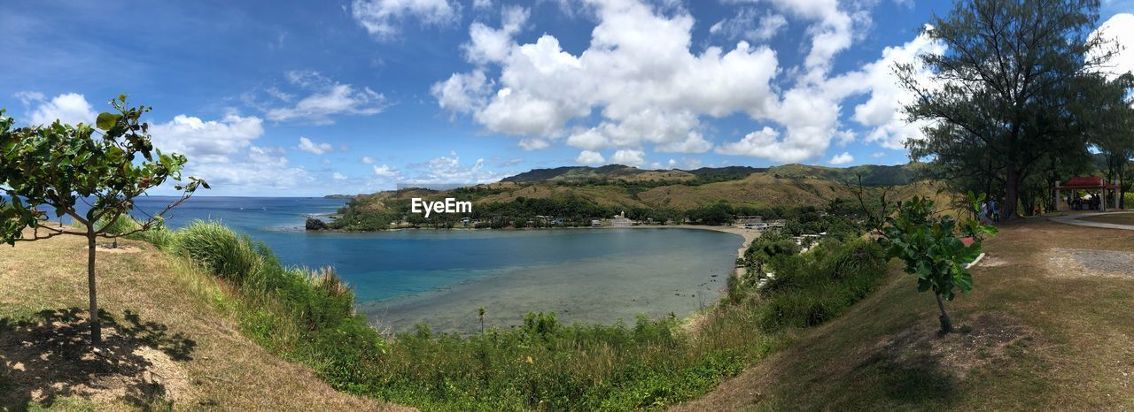 sky, water, cloud - sky, plant, tree, scenics - nature, tranquility, tranquil scene, beauty in nature, nature, land, landscape, beach, environment, sea, day, panoramic, no people, growth, outdoors