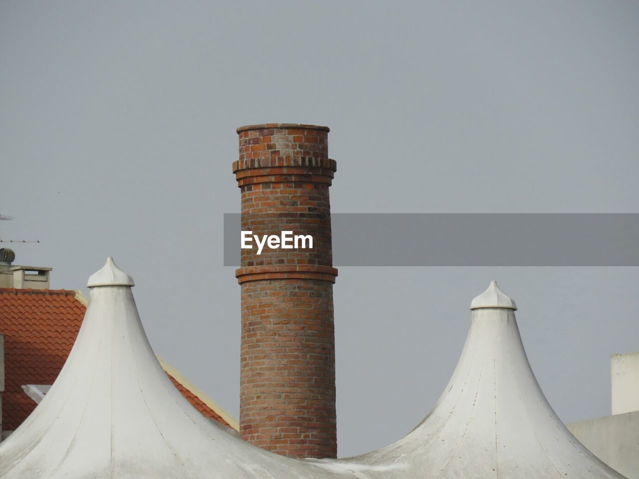 architecture, built structure, no people, clear sky, smoke stack, building exterior, day, outdoors, factory, sky