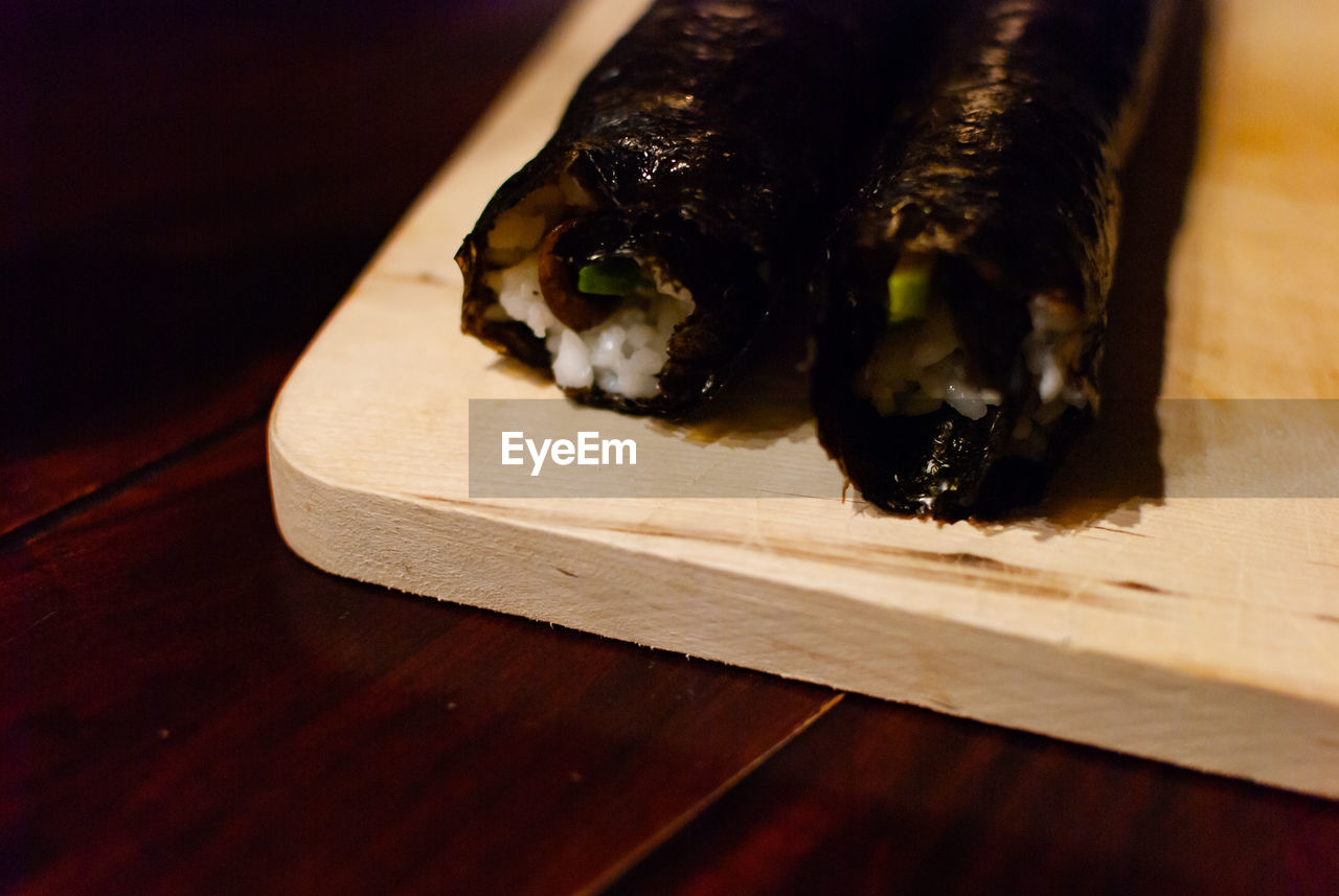 wood - material, table, indoors, food and drink, food, close-up, no people, freshness, cutting board, still life, ready-to-eat, animal, wellbeing, focus on foreground, selective focus, healthy eating, vertebrate, seafood, high angle view, asian food, japanese food, tray, temptation, snack