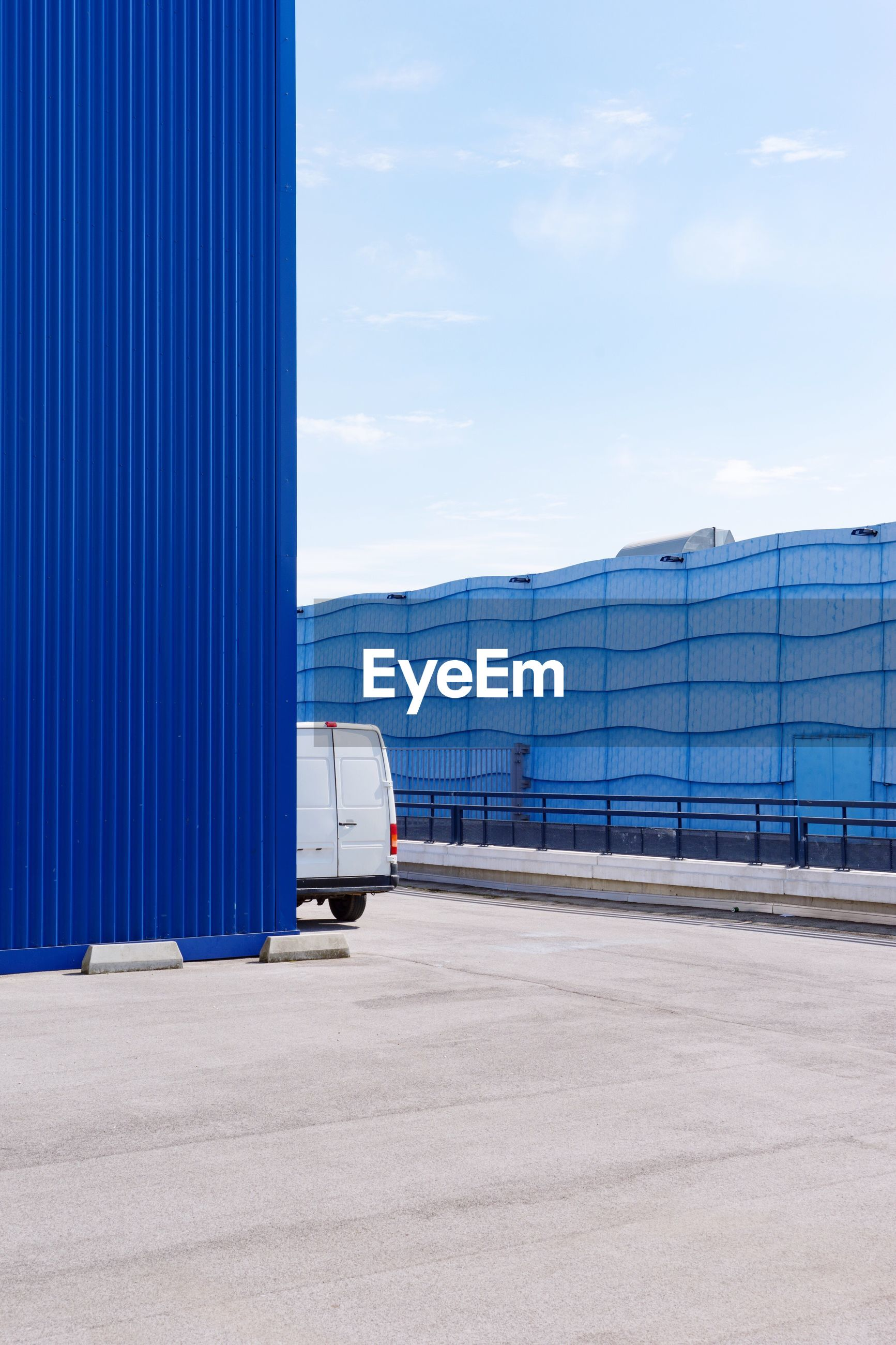 freight transportation, transportation, shipping, cargo container, container, day, no people, blue, industry, warehouse, sky, outdoors