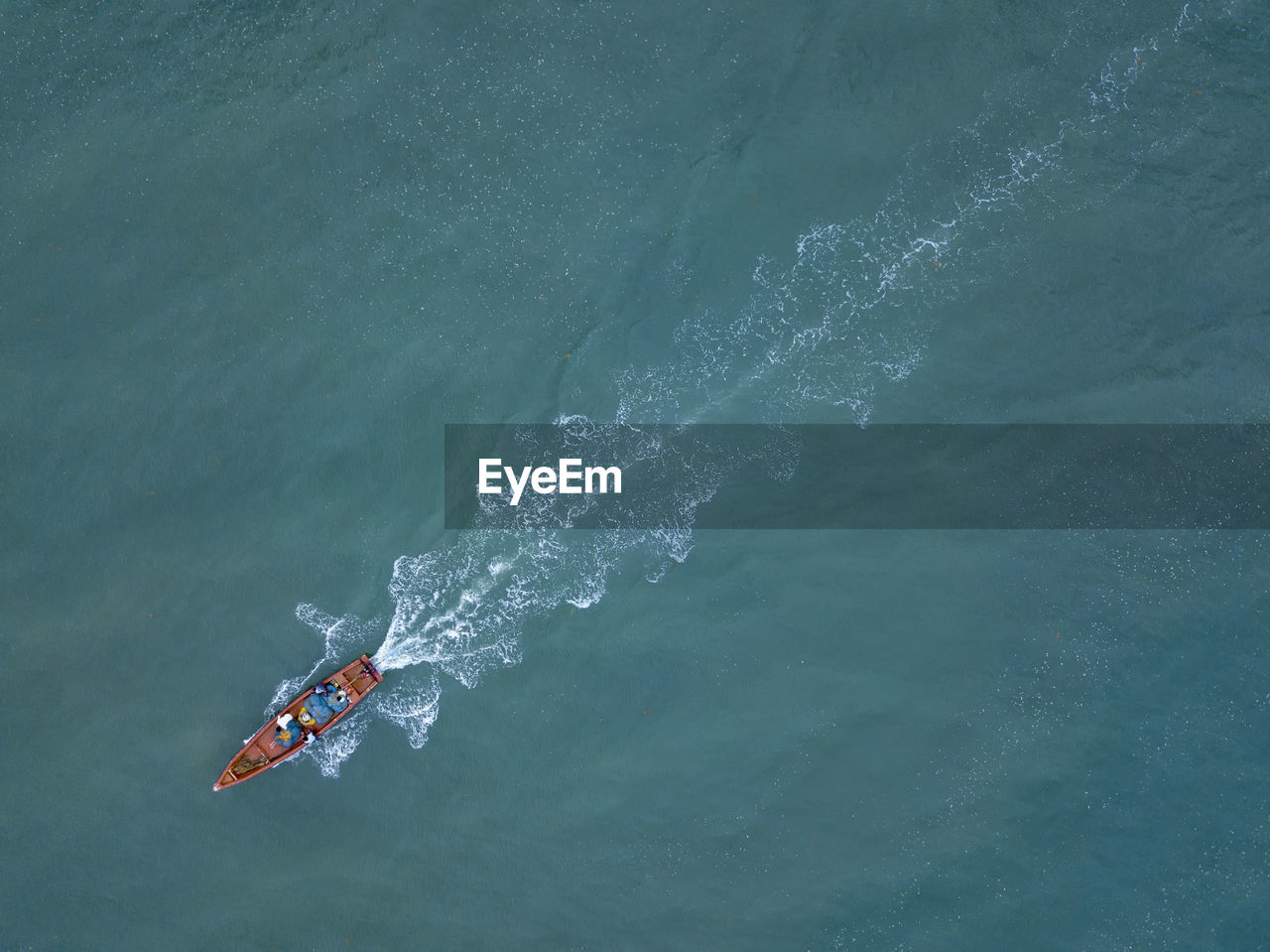 Aerial View Of People In Boat On Sea