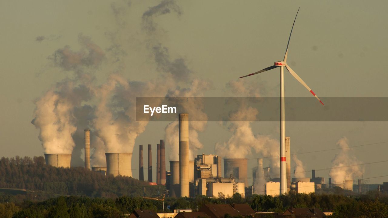 Smoke emerging from cooling towers at power plant