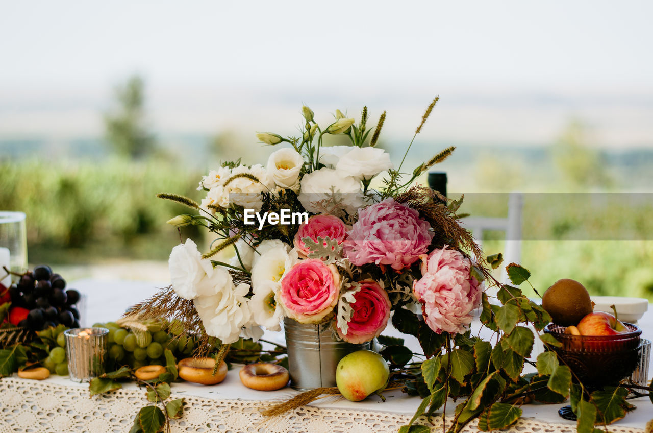 flowering plant, flower, plant, nature, freshness, focus on foreground, no people, wedding, decoration, beauty in nature, flower arrangement, arrangement, food and drink, celebration, table, event, bouquet, food, life events, close-up, flower head, wedding ceremony, setting