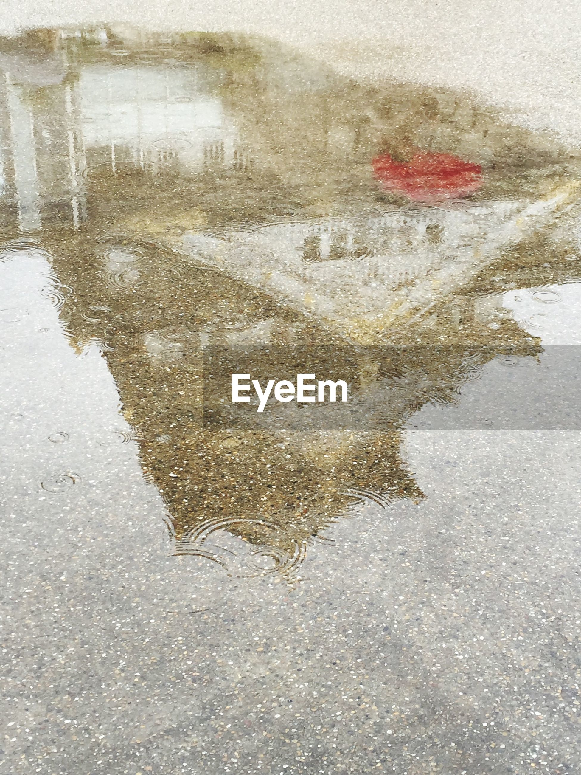 season, weather, wet, street, rain, road, water, cold temperature, winter, snow, puddle, asphalt, frozen, high angle view, day, reflection, monsoon, nature, outdoors, drop