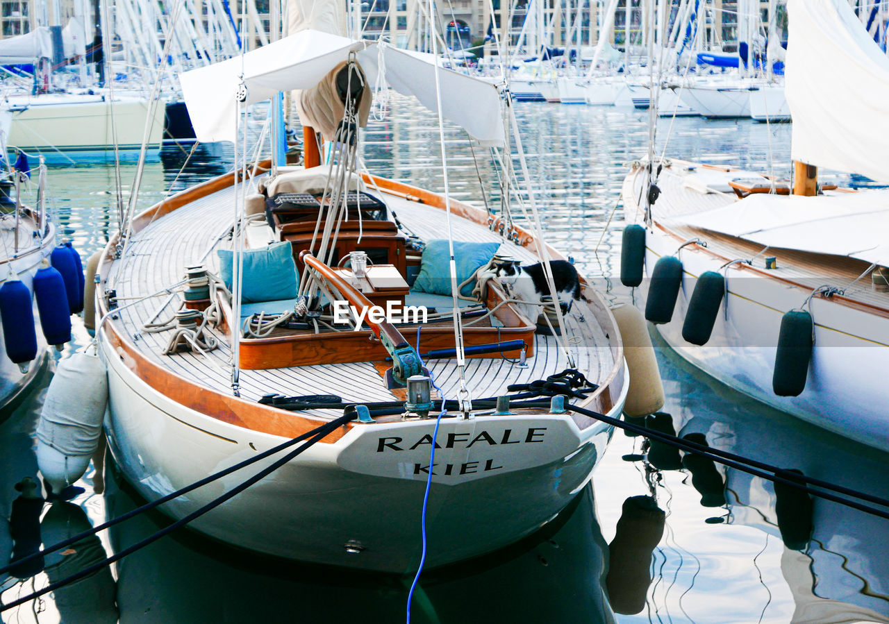nautical vessel, transportation, mode of transportation, moored, water, sea, harbor, rope, nature, high angle view, day, no people, sailboat, ship, deck, yacht, outdoors, sailing, boat deck, fishing boat