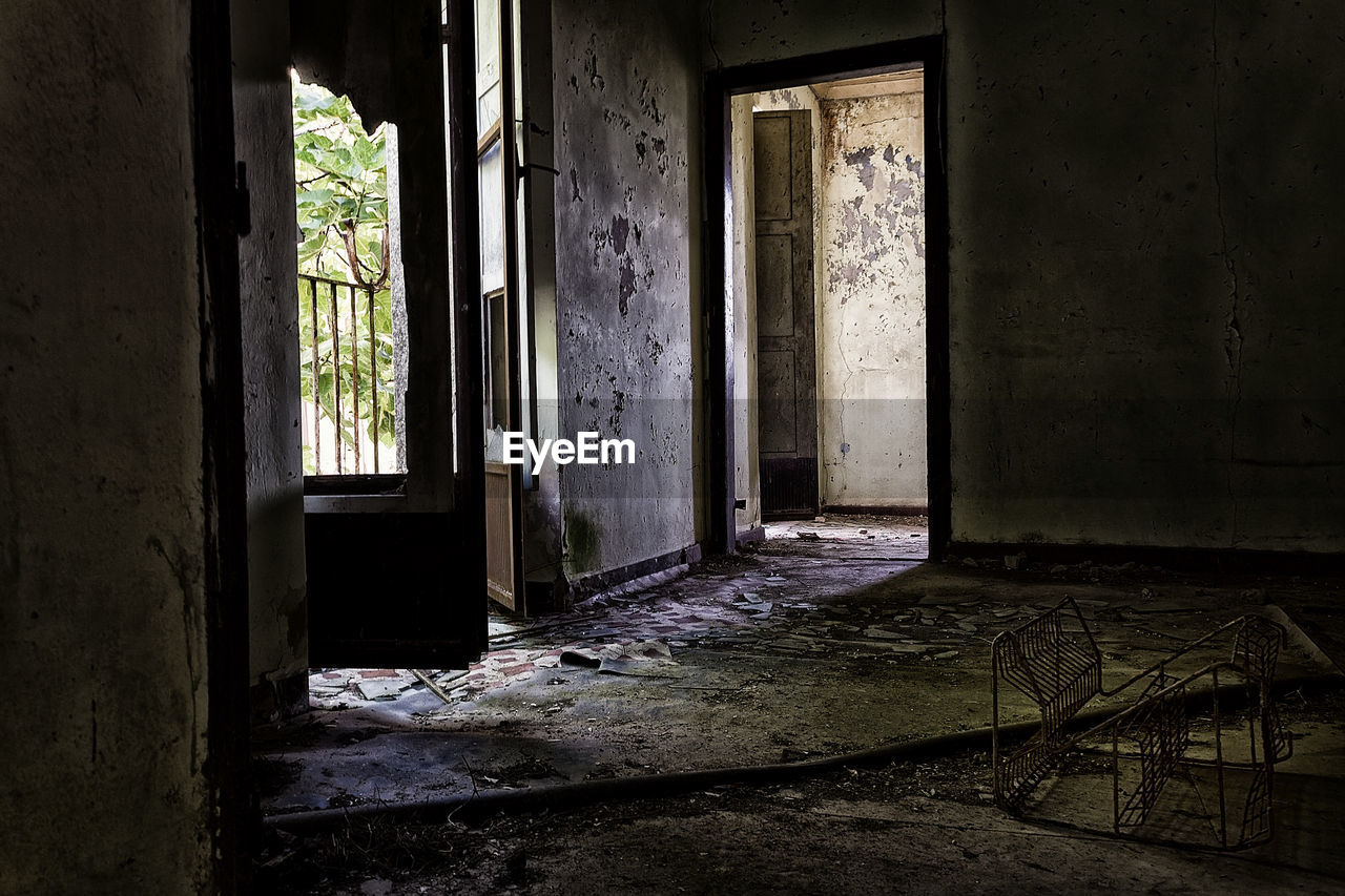 abandoned, architecture, building, window, indoors, entrance, door, built structure, no people, damaged, day, old, run-down, house, obsolete, domestic room, decline, bad condition, deterioration, weathered, ruined, flooring, dirty, messy