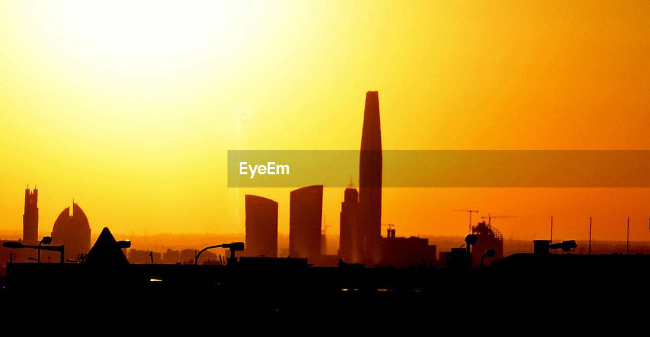 sunset, orange color, sky, building exterior, architecture, silhouette, built structure, city, nature, building, no people, copy space, skyscraper, office building exterior, tall - high, sun, landscape, urban skyline, cityscape, tower, outdoors