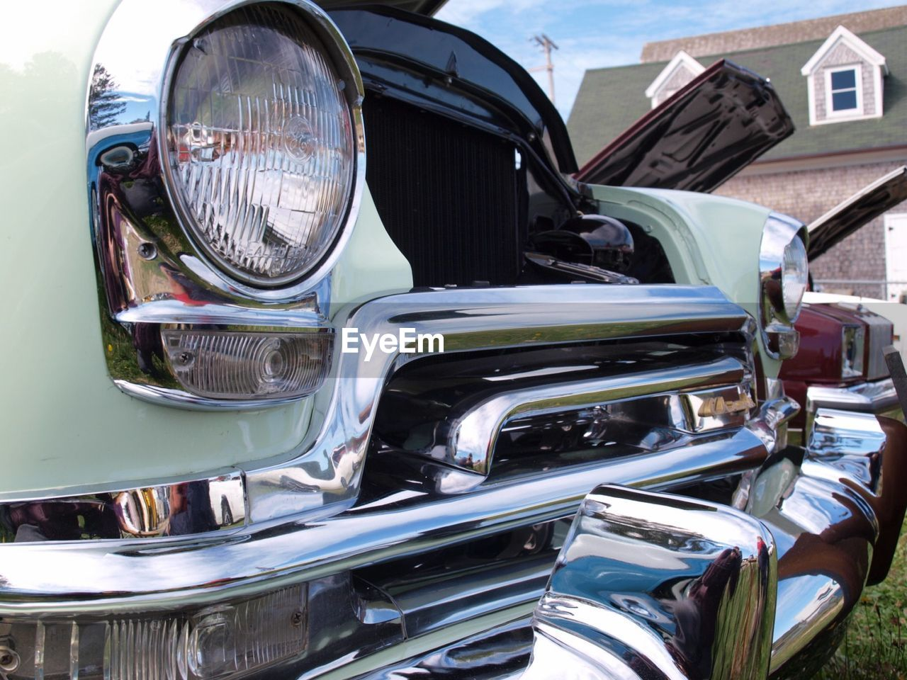 car, transportation, headlight, land vehicle, mode of transport, outdoors, day, close-up, no people, building exterior
