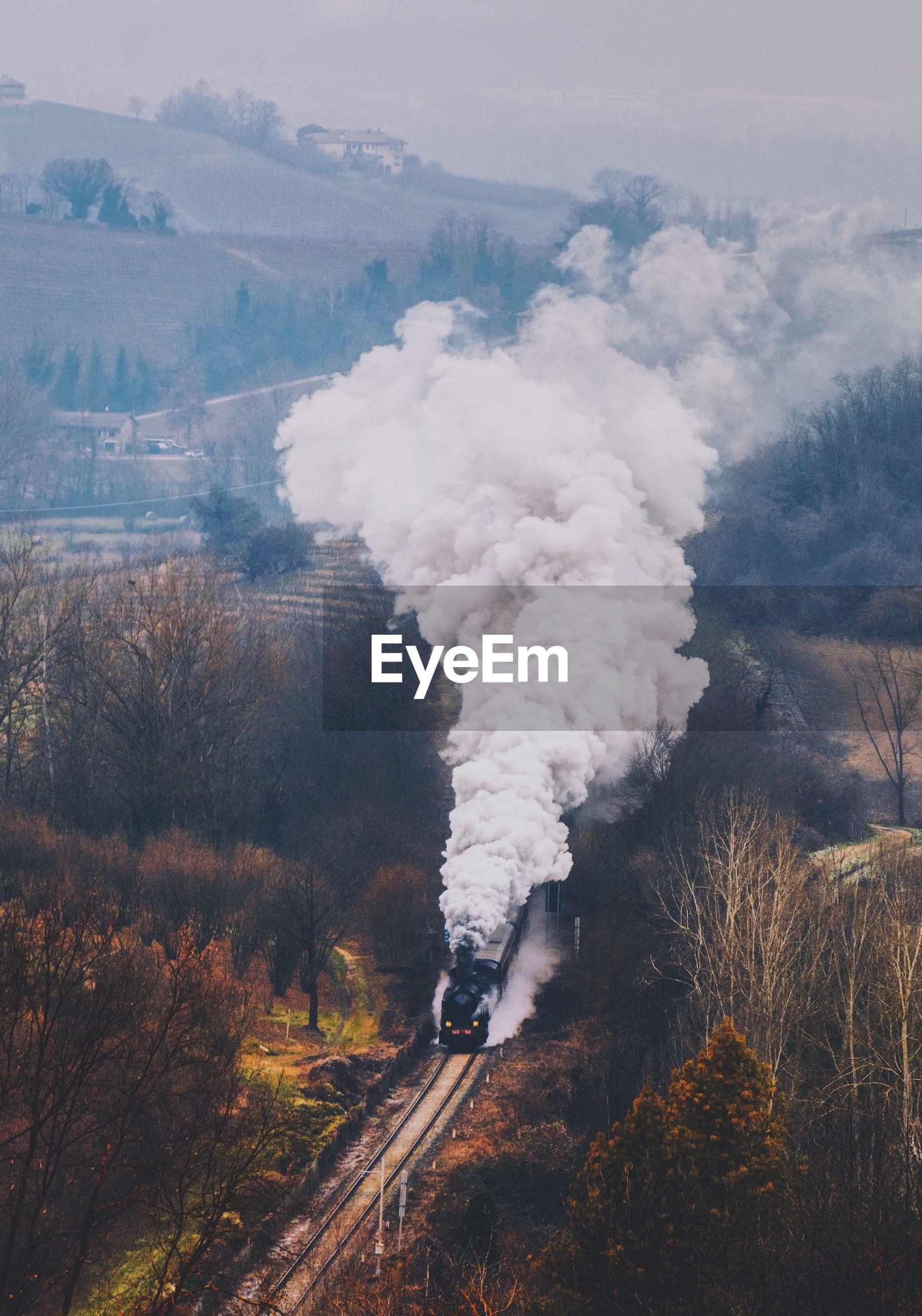 High angle view of smoke emitting train on railroad track