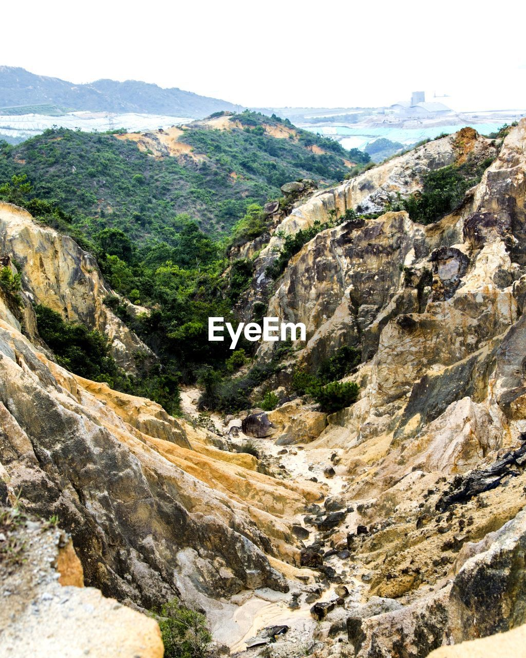 mountain, scenics - nature, nature, mountain range, rock, day, landscape, no people, beauty in nature, environment, tranquil scene, tranquility, sky, solid, outdoors, high angle view, plant, rock - object, rock formation, non-urban scene, formation, mountain peak
