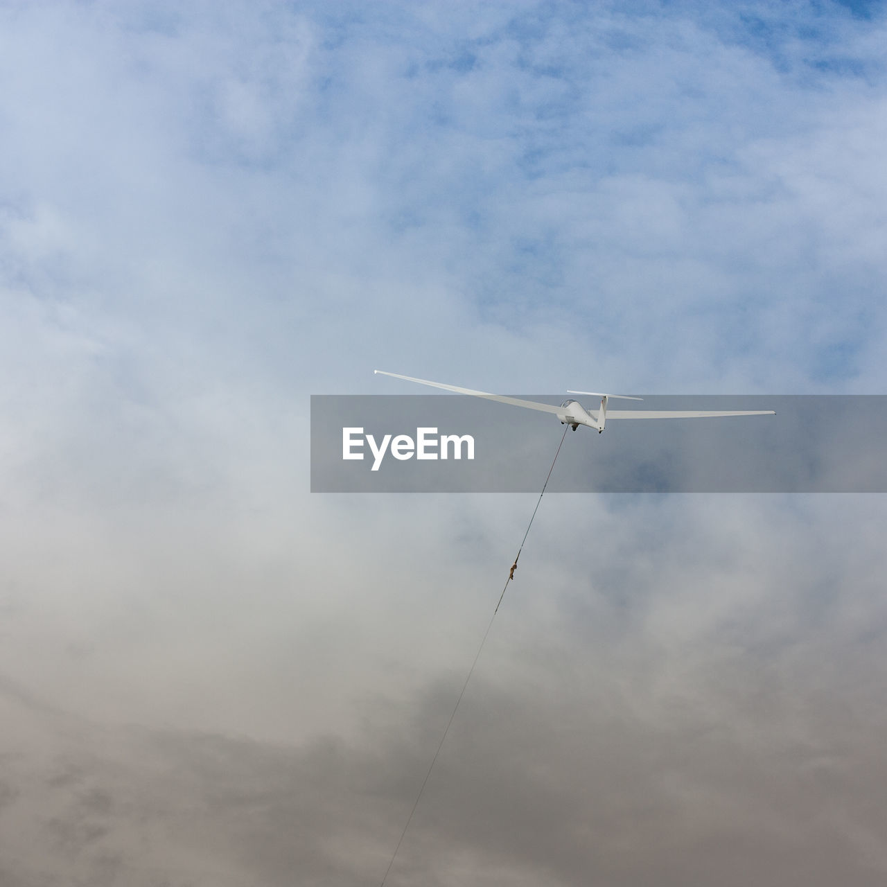 cloud - sky, sky, low angle view, flying, air vehicle, mid-air, no people, nature, day, airplane, motion, transportation, mode of transportation, outdoors, white color, on the move, fuel and power generation, vapor trail, beauty in nature, renewable energy, plane