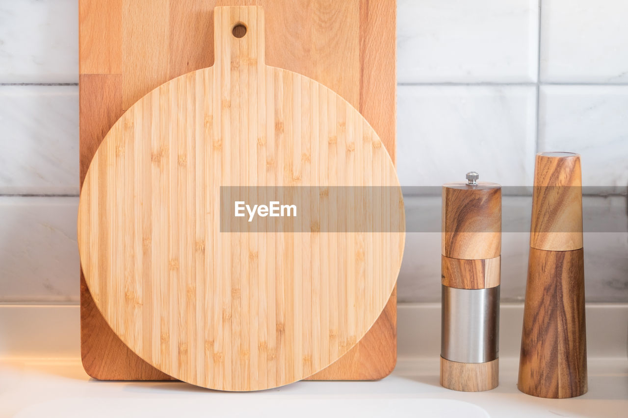 Close-up of wooden household equipment on kitchen counter
