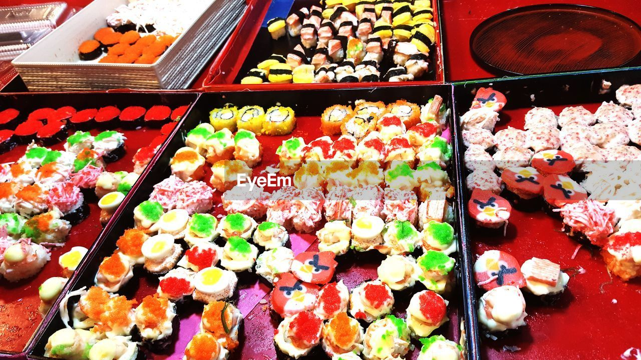 multi colored, variation, for sale, food and drink, choice, indulgence, food, indoors, unhealthy eating, sweet food, retail, arrangement, large group of objects, temptation, abundance, no people, store, high angle view, freshness, price tag, ready-to-eat, close-up, day
