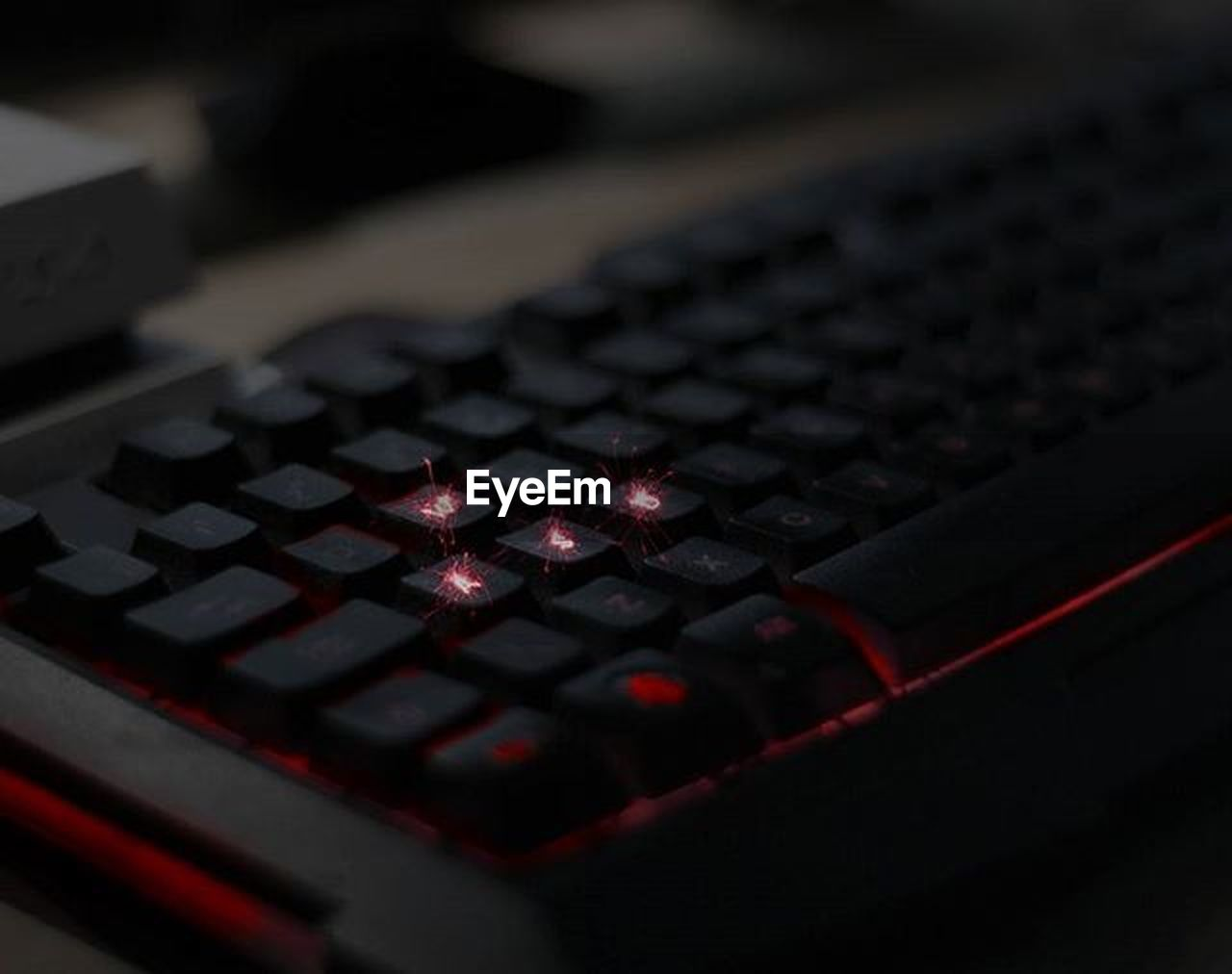 technology, close-up, keyboard, computer keyboard, no people, computer, indoors, computer equipment, connection, black color, communication, selective focus, computer part, finance, arts culture and entertainment, business, computer key, dark, red, keypad