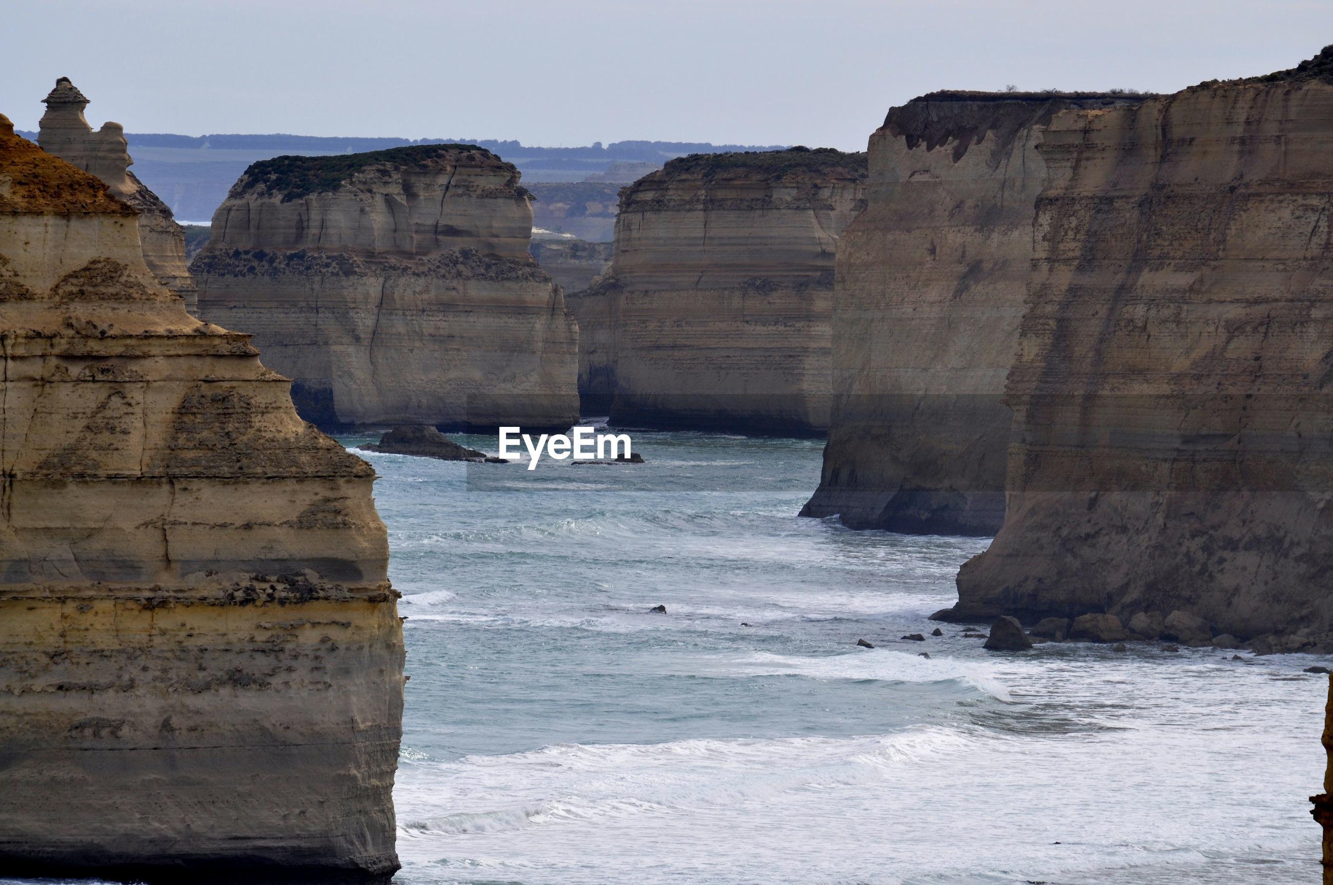 Stack rocks in sea against sky